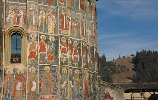 Images of Christian Orthodox saints adorn frescoes on the exterior church walls at the Monastery of Sucevita.