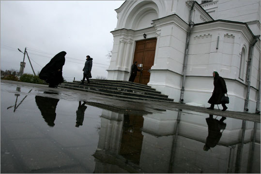 A nun and other Sunday afternoon faithful on the grounds of the Saint Efrosinya Monastery in Polack.
