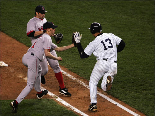 There was A-Rod's 'ball-slapping' incident (pictured) in 2004. There was the 'Mine' incident earlier this year. And there have been far too many unflattering appearances in the tabloids. Alex Rodriguez always seems to be involved in controversy, while Mike Lowell thrives away from the limelight. Because Lowell doesn't crave attention, we never get to see where he hangs out after games, or what kind of T-shirts his wife wears. Unlike with A-Rod's wife, we're pretty sure Mrs. Lowell's wardrobe doesn't come with profanities.
