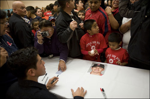 Ellsbury signs autographs during a ceremony in his honor at Kah-Nee-Tah High Desert Resort & Casino.