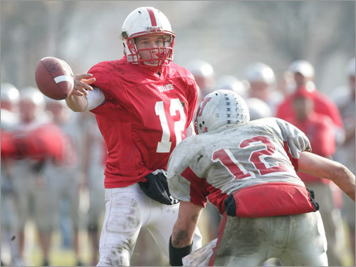 Melrose quarterback Dale Parsons slings a pass away from Wakefield's Brian Millea.