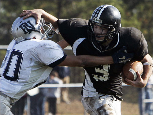 Plymouth South running back Blaine Theisen (3) tries to push off from Plymouth North's Corey Coleman (20).