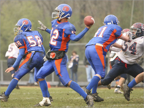 Newton South quarterback Derek Russell (12) prepared to launch a pass.