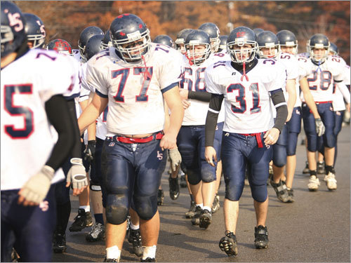 Lincoln-Sudbury marched back to the field after halftime.