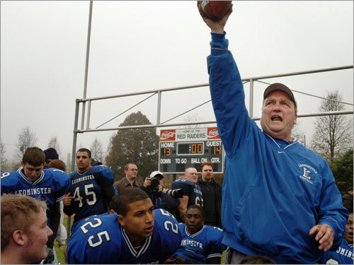 With the final score in the background, Leominster head coach John Dubzinski held up the game ball.