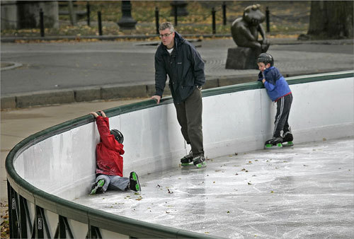 The Dodd family of Australia got their first taste of ice skating at the Boston Common Frog Pond on Nov. 16. Dad Bruce Dodd (center) and son Jamie Dodd looked on as daughter Emily (left) gripped the railing and tried to gain her balance.