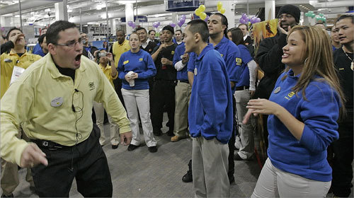 The Best Buy electronics store at the CambridgeSide Galleria opened its doors at 5 a.m. for customers on Black Friday. Customer Service Manager Ralph Gonzalez (left) inspired his employees and co-workers with a spirited speech.