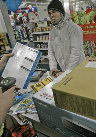 Emanuel Moreira of Everett bought some high-priced electronics at bargain prices during the early morning sale.