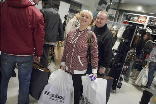 Alice Kinsella exited the store with bundles in tow and a smile on her face following her Black Friday shopping expedition.