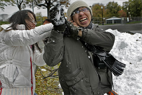 Karen Li (left) attempted to throw snow down the neck of Gary Lee in front of the frog pond in the Boston Common. The two students were on tour from Taiwan and it was their first time experiencing snow.