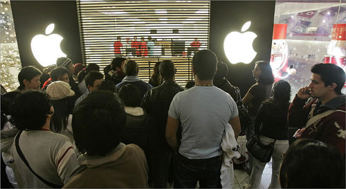 At the CambridgeSide Galleria, about fifty customers pressed towards the grates of the Apple store as the 7am opening drew closer. According to shoppers, deals on several new ipods were the main attraction of today's sale.