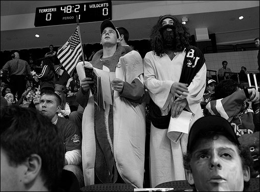 BOSTON -- Brian Fadem and Ross Lichtenberg are Boston University sophomores and fixtures at BU hockey games. Lichtenberg dresses as, well, Jesus. Fadem goes as a hot dog. It's not exactly clear why. Lichtenberg says something about hockey being 'more of a religion than a sport.' And Fadem says even non-believers can believe in hot dogs, adding: 'We did it last year, so we're doing it again.' Fadem's hot dog costume is a former Halloween costume the he wore in his native Pennsylvania. His mother made the felt condiments on the front and also made Lichtenberg's sash and logo. When asked what he hoped to leave behind to the BU community, Fadem said, 'I'll leave my toppings behind so that they can hang them from the rafters one day.' (Photo and Audio by Suzanne Kreiter, Globe Staff) audio: Brian Fadem and Ross Lichtenberg, AKA Hot Dog and Jesus, about their support for BU hockey. <object classid='clsid:02BF25D5-8C17-4B23-BC80-D3488ABDDC6B' width='200' height='30' codebase= 'http://www.apple.com/qtactivex/qtplugin.cab'>