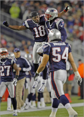 Patriots wide receiver Donte Stallworth (No. 18) jumped for joy with cornerback Asante Samuel (to his left) after the Patriots defender scored on a first-quarter interception return.