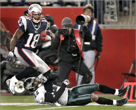 Patriot Donte Stallworth tried to break loose from the Eagles' Joselio Hanson as he eyed the end zone in the first half. Stallworth almost turned the ball over on the play trying to lateral the ball to teammate Wes Welker.
