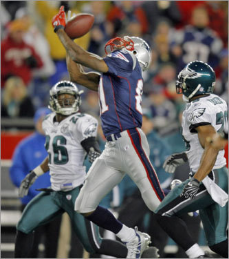 Patriots wide receiver Randy Moss couldn''t come up with this third-quarter pass from Tom Brady.