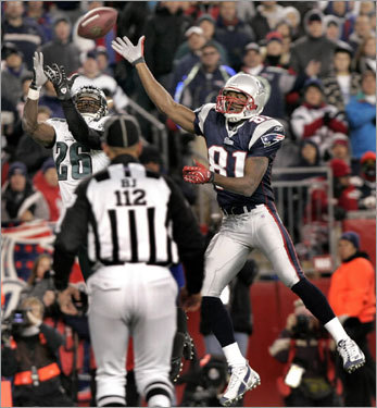 The Eagles' Lito Sheppard almost intercepted a pass intended for Patriots wide receiver Randy Moss. The Eagles were able to limit Moss's productivity during the Pats' 31-28 win.