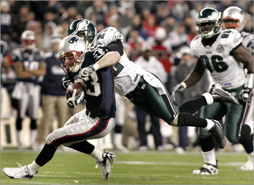 Patriots wide receiver Wes Welker was brought down by the Eagles' Joselio Hanson after a long gain in the fourth quarter.