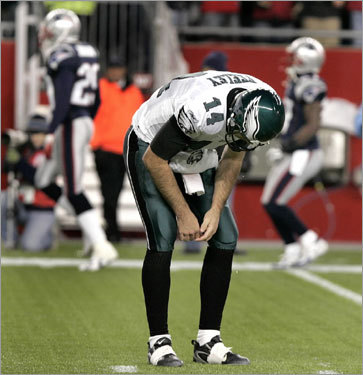 Eagles quarterback A.J. Feeley reacted after throwing a last-ditch pass for an interception to end the Eagles' hopes of an upset of the Patriots.
