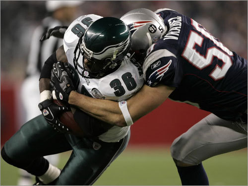 Eagles running back Brian Westbrook (left) was tackled by Patriots linebacker Mike Vrabel in the first half.