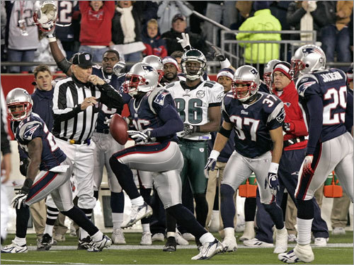Patriots defender James Sanders celebrated after intercepting a pass intended for the Eagles' Reggie Brown (No. 86 in background) to preserve the win and remain undefeated.