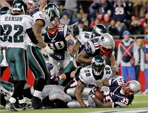 Patriots running back Laurence Maroney broke into the end zone ahead of the Eagles' Brian Dawkins (No. 20) for the game-winning touchdown in the fourth quarter.