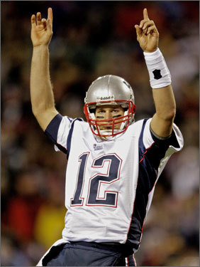 Tom Brady broke Peyton Manning's record for the most touchdown passes in a season Saturday night, throwing his 49th and 50th scoring strikes against the Giants (Manning's record stood at 49 TD passes). Both receptions were made by Randy Moss, who broke a record of his own.