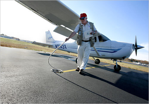 Roger Lee, a flight instructor for King Aviation, which runs out of Mansfield Airport, performs pre-flight checks on a Cessna 172 SP aircraft.