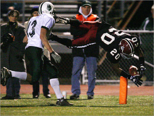Dartmouth's Mike Hudson can only watch as Brockton's Josh Marsh(20) leaps into the end zone for the Boxers' lone touchdown of the game.