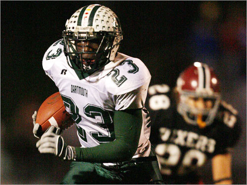 Dartmouth's Jordan Todman (23) runs down the field as Brockton's Alex White pursues.