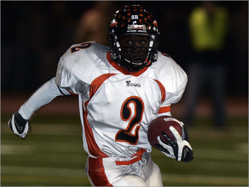 Wayland running back Michael Mitchell (2) looks for running room.