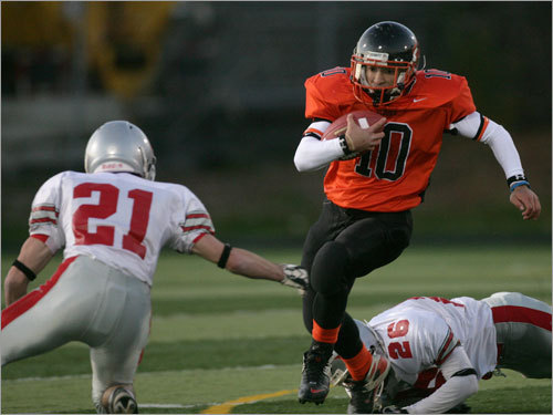Greater Lawrence's Nate Adames (10) evades the tackles of Kevin Johnston (21) and Jesse Burrell (26).