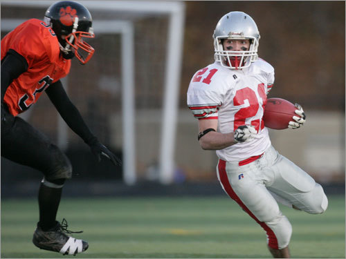 Amesbury's Kevin Johnston (21) looks for room to run.