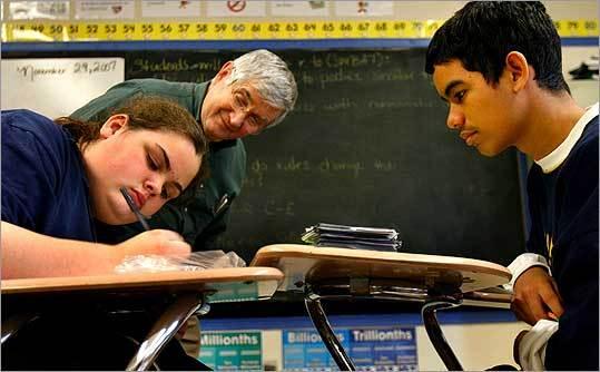 Tutor Ed Baratta watched Gina Cunningham and Gabriel Cartagena play a math game at a Charlestown school.