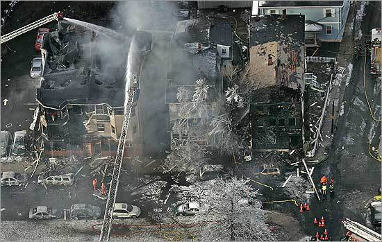 An aerial photo showed the devastation from a tanker truck fire that spilled a river of flaming gasoline down the street.