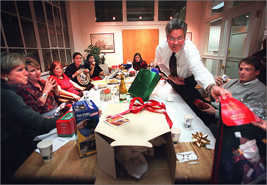 No gag gifts If your office participates in a Secret Santa, don't give joke or passive-aggressive gifts, such an alarm clock for the person who's always late, Robin Abrahams says. Shown from right : Workers at Conventures enjoy a rather sedate holiday party with a Yankee swap.