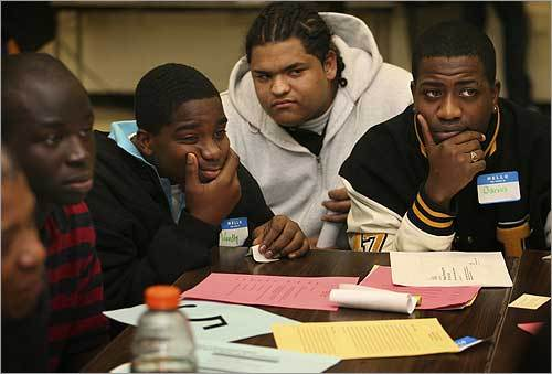 Woodly Dodieu (left, with blue collar), 16, José Manuel Baez (center, in grey hoodie), 16, and Darius Cohen (far right), 17, met at Madison Park High School in Roxbury on Nov. 29 to discuss causes of the high drop-out rate and potential solutions.