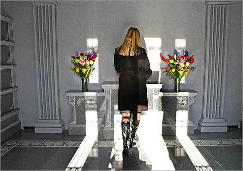 Alison Hudson inside the family columbarium at Blue Hills Cemetery in Braintree. The structure features 44 urn niches and can hold the remains of as many as 200 people.