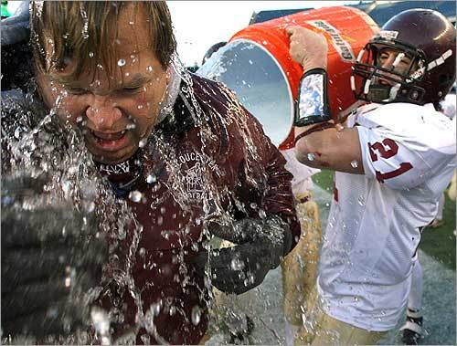 Gloucester's Andrew Fulford dumped a bucket of water over the head of assistant coach Tom Walsh at the end of the school's Super Bowl game against Hingham. Gloucester beat Hingham, 41-0, with Fulford carrying the ball 10 times for 105 yards.