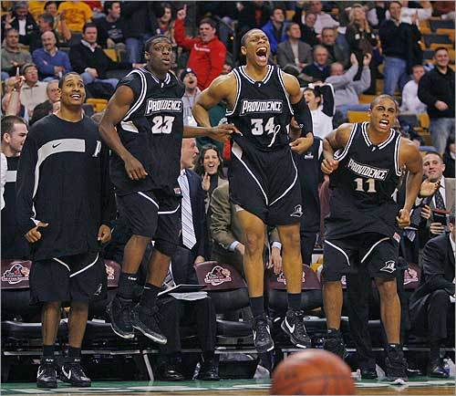The Providence bench leaped for joy after teammate Jamine Peterson hit a bucket (and got fouled in the process), putting the Friars ahead 83-76 against Boston College in overtime. Providence went on to win, 98-89, in the nightcap of the Hartford Hall of Fame Showcase on Dec. 1.