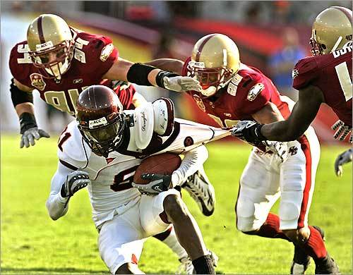 The Boston College defense tried to corral Virginia Tech's Justin Harper in the second half of the Atlantic Coast Conference championship game.