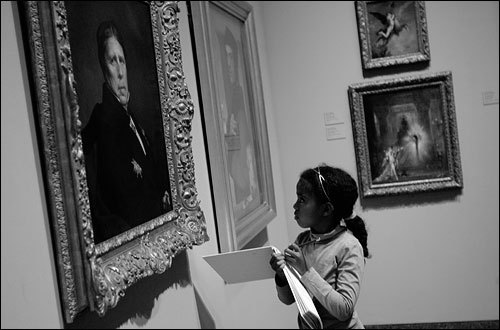 CAMBRIDGE -- The Fogg Art Museum at Harvard University has been open to the public since 1895 and is in the second year of a community outreach program that encourages local children to study and sketch classic and modern art. 'When you help them see, you build confidence and thinking skills,' says artist and educator Deborah Putnoi. 'When you ask a child to look at something and articulate what he sees, then suddenly you find someone with more confidence about art. ' As part of the Sketching After School program, nine year old Eden Shiferaw gets up close with a self portrait of French painter Jean-Auguste-Dominique Ingres. Eden says, 'I like drawing because you can draw how you feel.' (Photo and Audio by Suzanne Kreiter, Globe Staff) audio: Portrait of the artist. <object classid='clsid:02BF25D5-8C17-4B23-BC80-D3488ABDDC6B' width='200' height='30' codebase= 'http://www.apple.com/qtactivex/qtplugin.cab'>