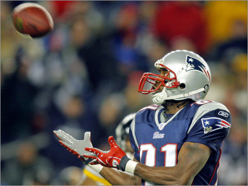 Patriots wide receiver Randy Moss hauled in his second touchdown pass of the game on a long bomb from Tom Brady in the second quarter.