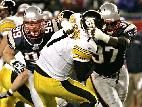 Patriots defensive lineman Jarvis Green (97) wrapped up Pittsburgh Steelers quarterback Ben Roethlisberger for a sack.