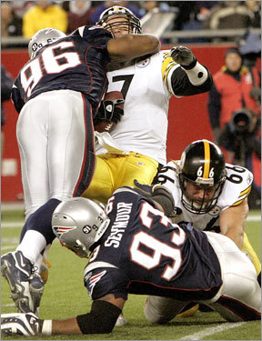 Patriots linebacker Adalius Thomas (96) sacked Pittsburgh Steelers quarterback Ben Roethlisberger (7) during the fourth quarter.