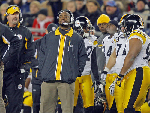 Steelers head coach Mike Tomlin on a somber Pittsburgh sideline.