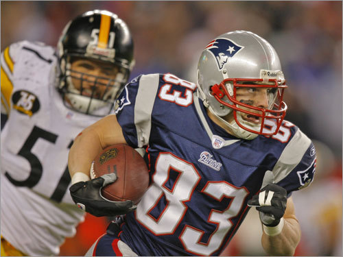 Patriots wide receiver Wes Welker (83) left the Steelers' James Farrior in the dust after making a reception.