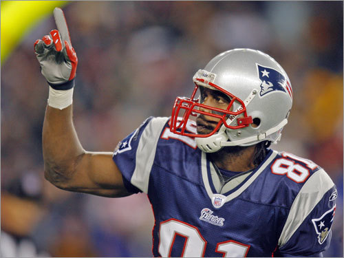 Randy Moss pointed to the crowd after his first touchdown reception of the game.