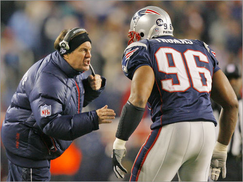 Patriots head coach Bill Belichick shouted instructions to linebacker Adalius Thomas.