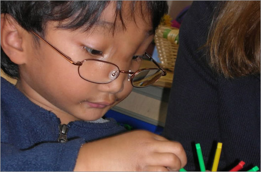Roth Arun,5, a Lenox, Mass. boy was adopted from a Cambodian orphanage three years ago. His foster money helped raise money for his recent treatment for several congenital deformities at Children's Hospital Boston.