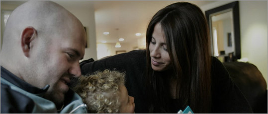 Enza Sambataro and Red Sox player Kevin Youkilis are pictured at home in Newton with her son, Michael.